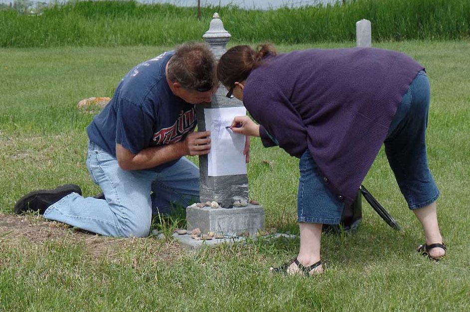 Dave and Stephanie tracing the headstone